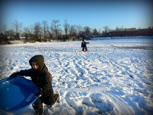 Laith sledding with Salma